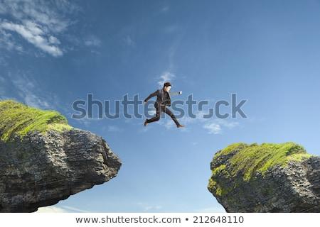 Man jumping across stream Stock photo © IS2