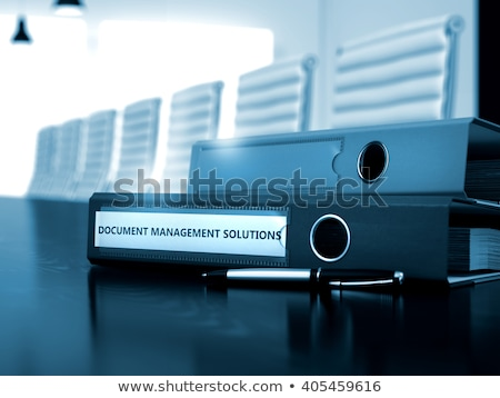Document Management Solutions on Office Binder. Toned Image. Stock photo © tashatuvango