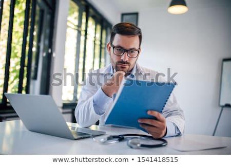 Portré töprengő fiatal férfi orvos sztetoszkóp egyenruha Stock fotó © deandrobot