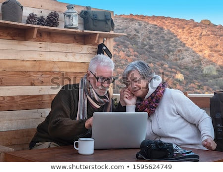 man and woman at mountain top bar Stock photo © IS2
