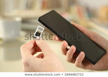 Pessoas mão micro telefone móvel telefone Foto stock © AndreyPopov