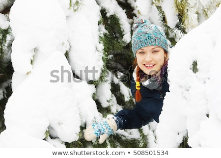 Young girl peeking from behind tree Stock photo © IS2