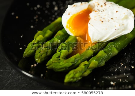Plate of poached egg and asparagus Stock photo © IS2