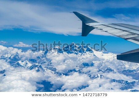 Plane window with a view on the Himalayas Stock photo © dutourdumonde