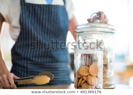 Waitress holding jar and tong in café Stock photo © wavebreak_media