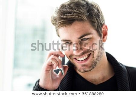 Gülen adam fütüristik cep telefonu beyaz mutlu Stok fotoğraf © wavebreak_media