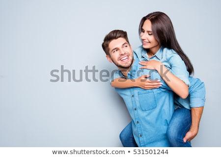 Izgatott fiatalember hordoz barátnő hát sétál Stock fotó © deandrobot