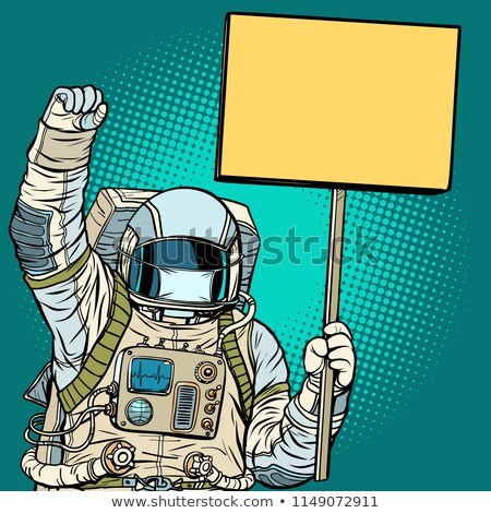 Astronaut in a medical mask protests with a poster Stock photo © studiostoks