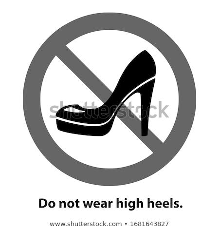 young businesswoman wearing high heels walking to side Stock photo © feedough