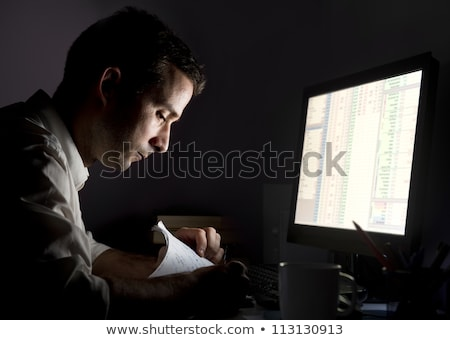 man with papers and coffee working at night office Stock photo © dolgachov