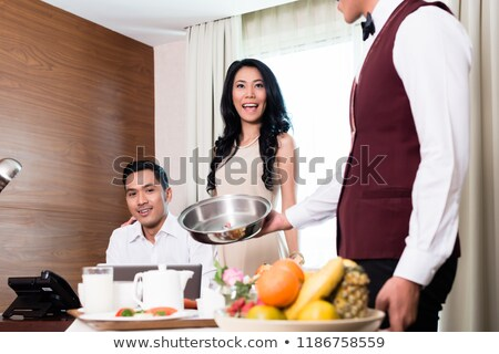 Couple looking at variety of fruits in restaurant Stock photo © Kzenon