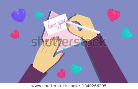 Hand holding envelope with words around Stock photo © ra2studio