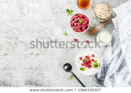 Organic homemade Granola Cereal with oats and fresh berries. Texture oatmeal granola or muesli in ag Stock photo © artjazz