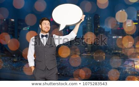 man with blank text bubble over singapore city stock photo © dolgachov