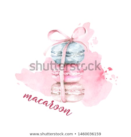 Pink dessert cake macaron or macaroon with white sweet flowers on stone kitchen background. Top view Stock photo © DenisMArt