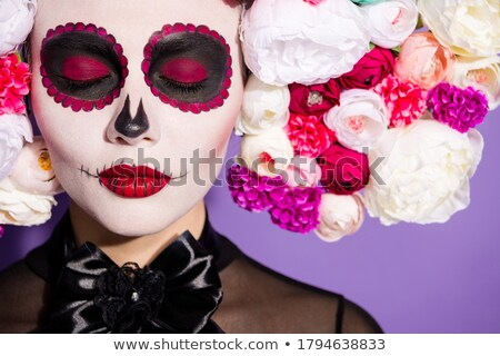 Frightening woman wearing black costume and halloween makeup hol Stock photo © deandrobot