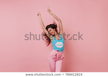 Fashionable brunette woman happy posing and dancing. Stock photo © studiolucky