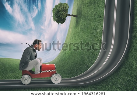 Businessman climb an uphill road with a small car. Difficult carrer concept Stock photo © alphaspirit
