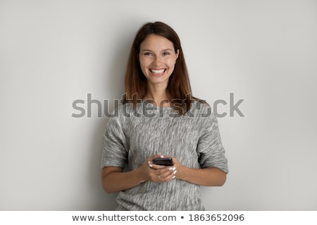 young beautiful, caucasian, red haired, internet addicted woman working bored, sleepless and tired o Foto stock © galitskaya
