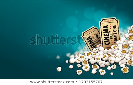 gold cinema tickets in popcorn online movie banner stock photo © loopall