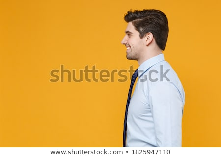 Image of office worker man wearing white shirt looking aside, wh Stock photo © deandrobot