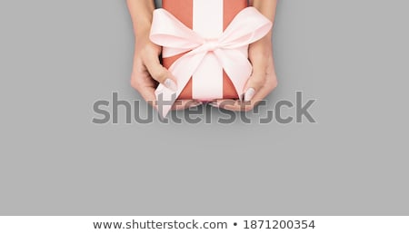 female hands with a gentle manicure in bright colors holding an invitation to the envelope for a wed stock photo © vbdpua