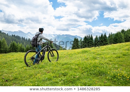 Main On Mountain With His Bike Stock photo © AndreyPopov