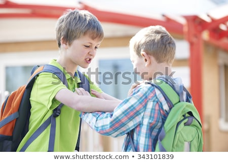 A boy bullying in school playground Stock photo © Lopolo