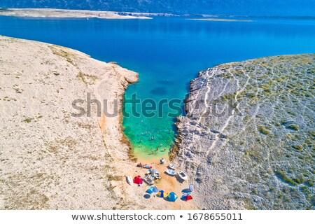 Zadar archipelago idyllic cove beach in stone desert scenery nea Stock photo © xbrchx