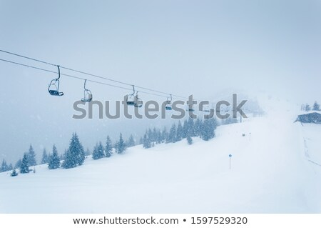 Empty chairlift in Austrian Alps. Stock photo © lichtmeister