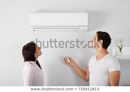 Coppia temperatura condizionatore d'aria home casa felice Foto d'archivio © AndreyPopov
