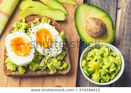 Toast with avocado and egg on rustic wooden background Stock photo © galitskaya