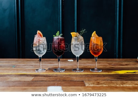 Four cocktail glasses stock photo © karandaev