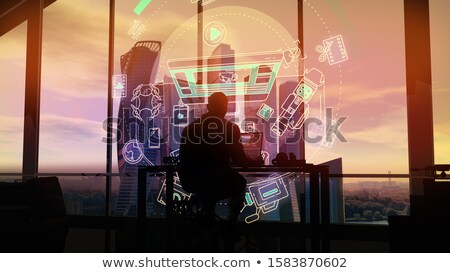 Male videographer working on virtual infographic background Stock photo © ConceptCafe