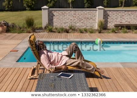 Oldalnézet idős afroamerikai férfi alszik nap Stock fotó © wavebreak_media