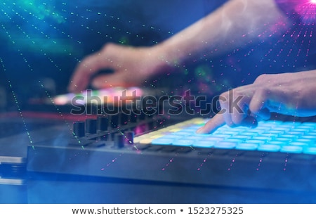 mixing music on midi controller with party club colors around stock photo © ra2studio