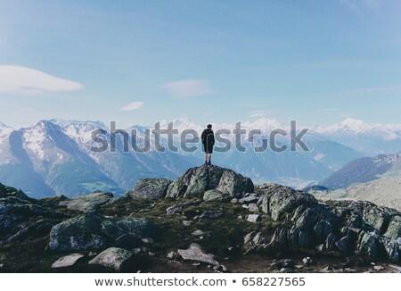 Young man climbing on a rock in Swiss Alps Stock photo © lightpoet