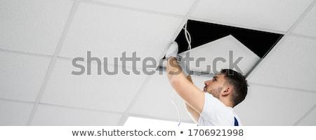Elettricista illuminazione soffitto ritratto ufficio Foto d'archivio © AndreyPopov