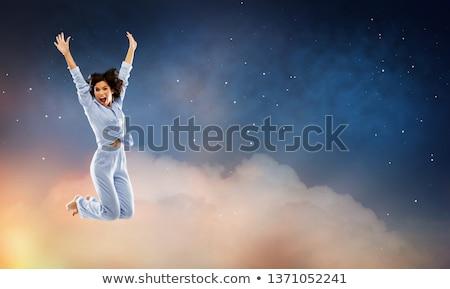Szczęśliwy kobieta niebieski skoki nieba zabawy Zdjęcia stock © dolgachov