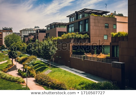 Residential buildings and gardens on the streets of Milan in Northern Italy, classic and historical  Stock photo © Anneleven