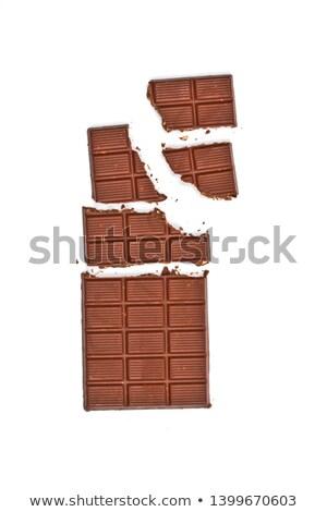 Broken milk chocolate bar wit hazelnuts. Stock photo © marylooo