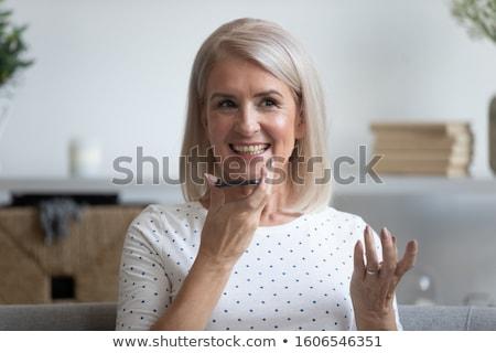 Idős nő fordító okostelefon technológia online Stock fotó © dolgachov