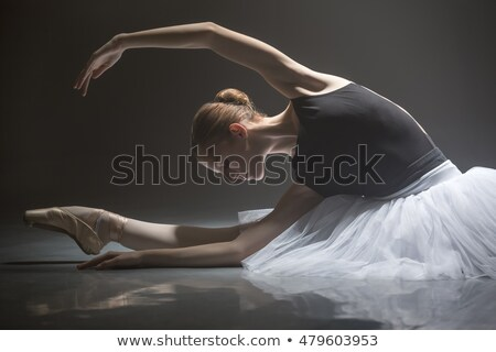 Image of caucasian young woman ballerina stretching her body usi Stock photo © deandrobot
