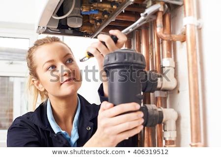 Smiling female plumber Stock photo © photography33