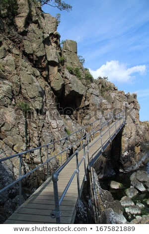 Houten brug steen muren stream verweerde Stockfoto © pixelsnap