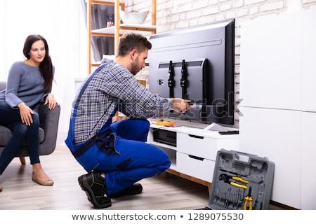 woman repairing television stock photo © photography33
