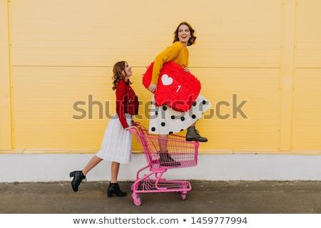 two female beauties in a dancing pose stock photo © konradbak