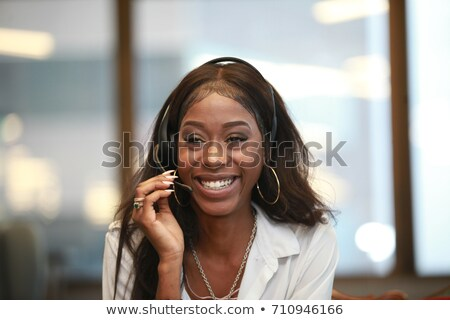 black receptionist with earphones Stock photo © photography33