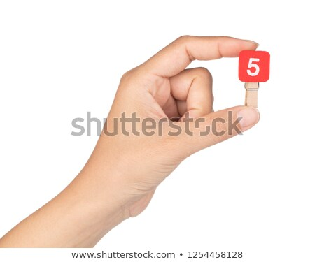 Stock photo: hand holding a red Clothespin