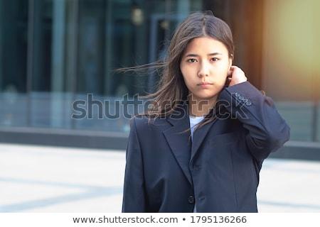 ciddi · bakmak · portre · genç · katlanmış · silah - stok fotoğraf © Pietus